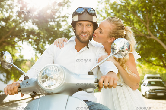 Attractive couple with their scooter