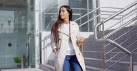 Stylish woman walking down a flight of stairs
