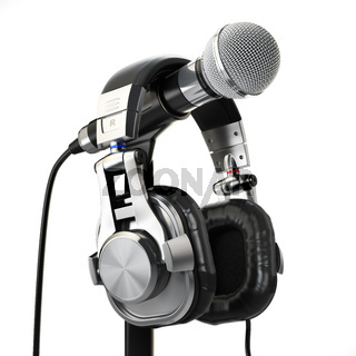 Microphone and headphones isolated on white. Audio recording concept.