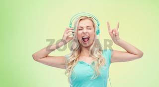 happy young woman or teenage girl with headphones