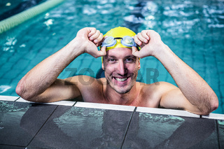 Fit swimmer lean on edge of the swimming pool