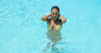 Beautiful Young Woman Refreshing at Swimming Pool