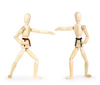 Two karate men are fighting. Abstract image with wooden puppets
