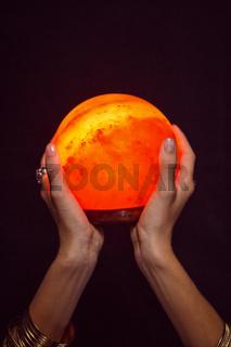 Fortune teller holding crystal ball