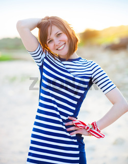 Portrait of the beautiful teen girl near the sea