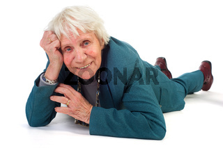 Elderly woman is laying at the floor