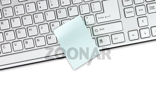 Keyboard and blank memo isolated on white
