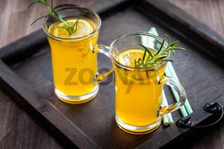 Homemade lemonade with lemon and rosemary