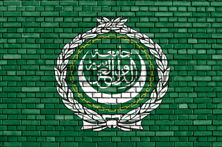 flag of Arab League painted on brick wall