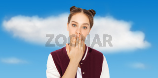 confused teenage girl covering her mouth by hand