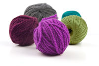Several balls of wool on a white background