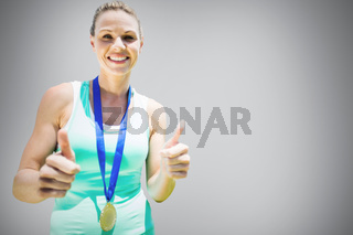 Composite image of portrait of smiling sportswoman holding a medal after a victory