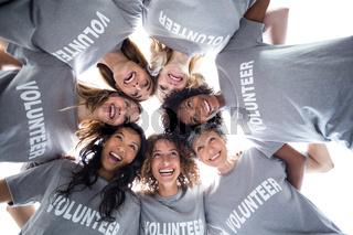Happy volunteers forming a huddle
