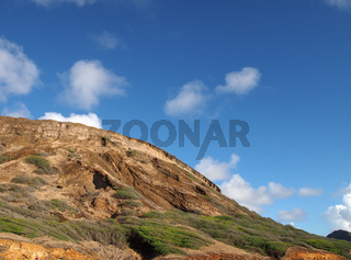 Close-up of top of Koko Head Mountain with sky visible