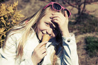Teenage girl eating an ice cream