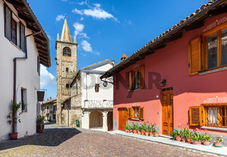 Colorful houses and old church in small italian town.