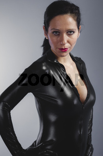 beautiful brunette with black suit, armed and dangerous latex, sensuality and slim body