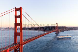 gold gate bridge in blue sky at dawn