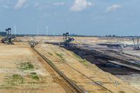 Overburden excavator, coal excavators and conveyor system in an open pit