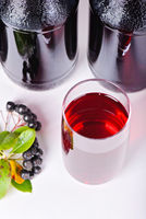 Syrup made from aronia, berries, glass and bottles