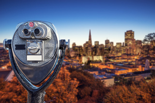 touristic telescope with cityscape of San Francisco and skyline