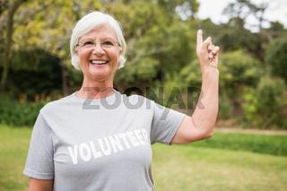 Happy volunteer grandmother with thumbs up