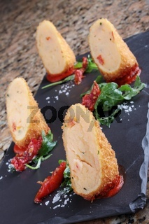 plated potato croquette appetizer starter