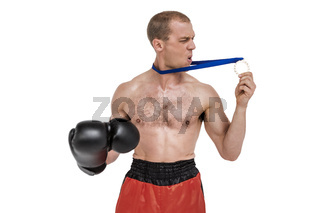 Unhappy boxer looking at his silver medal