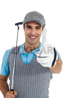 Portrait of golf player showing thumbs up