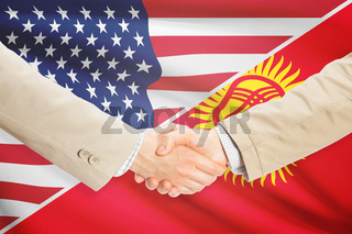 Businessmen shaking hands - United States and Kyrgyzstan