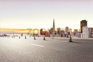road with cityscape of San Francisco and skyline