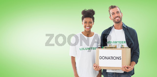 Composite image of smiling young couple with clothes donation