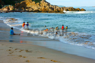 Asian children, swim, Vietnam beach