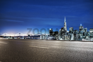 empty asphalt road with cityscape and skyline of san francisco at twilight