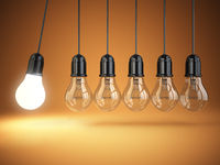 Idea o creativity concept. Light bulbs and perpetual motion.