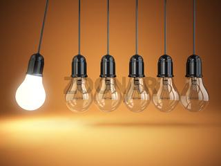 Idea o creativity concept. Light bulbs and perpetual motion.