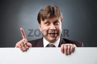 Businessman with index finger up