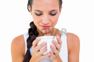 Pretty brunette having cup of tea