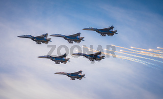 Silhouettes of russian fighter aircrafts SU-27 in the sky