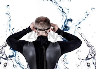 Composite image of rear view of swimmer in wetsuit wearing swimming goggles