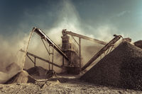 Industrial background with working gravel crusher