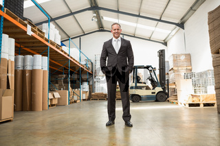Warehouse manager standing with hands in the pocket
