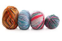 melange few balls of wool on a white