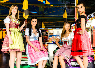 Gorgeous young women at German funfair