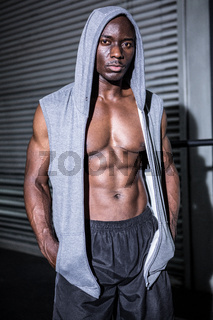 Young Bodybuilder in a hoodie looking at the camera