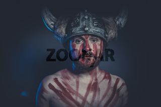 Leadership, Viking warrior with a horned helmet and war paint on his face