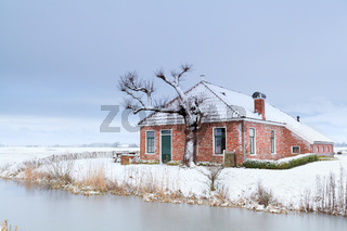 charming house in winter snow by river