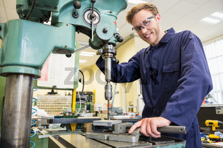 Engineering student using large drill