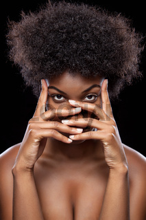 Young African beauty covering face with hands