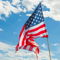 USA flag with clouds on background - outdoors shoot